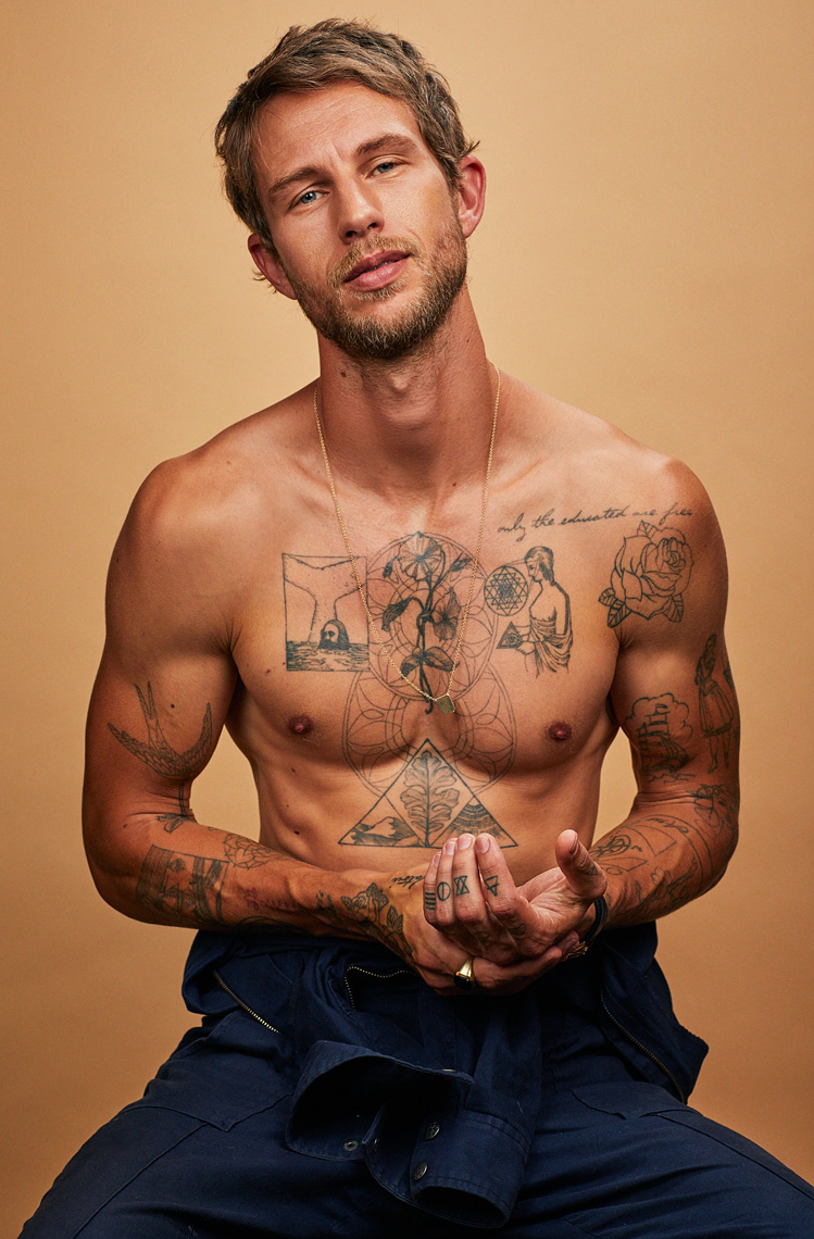 Portrait of shirtless man with tattoos