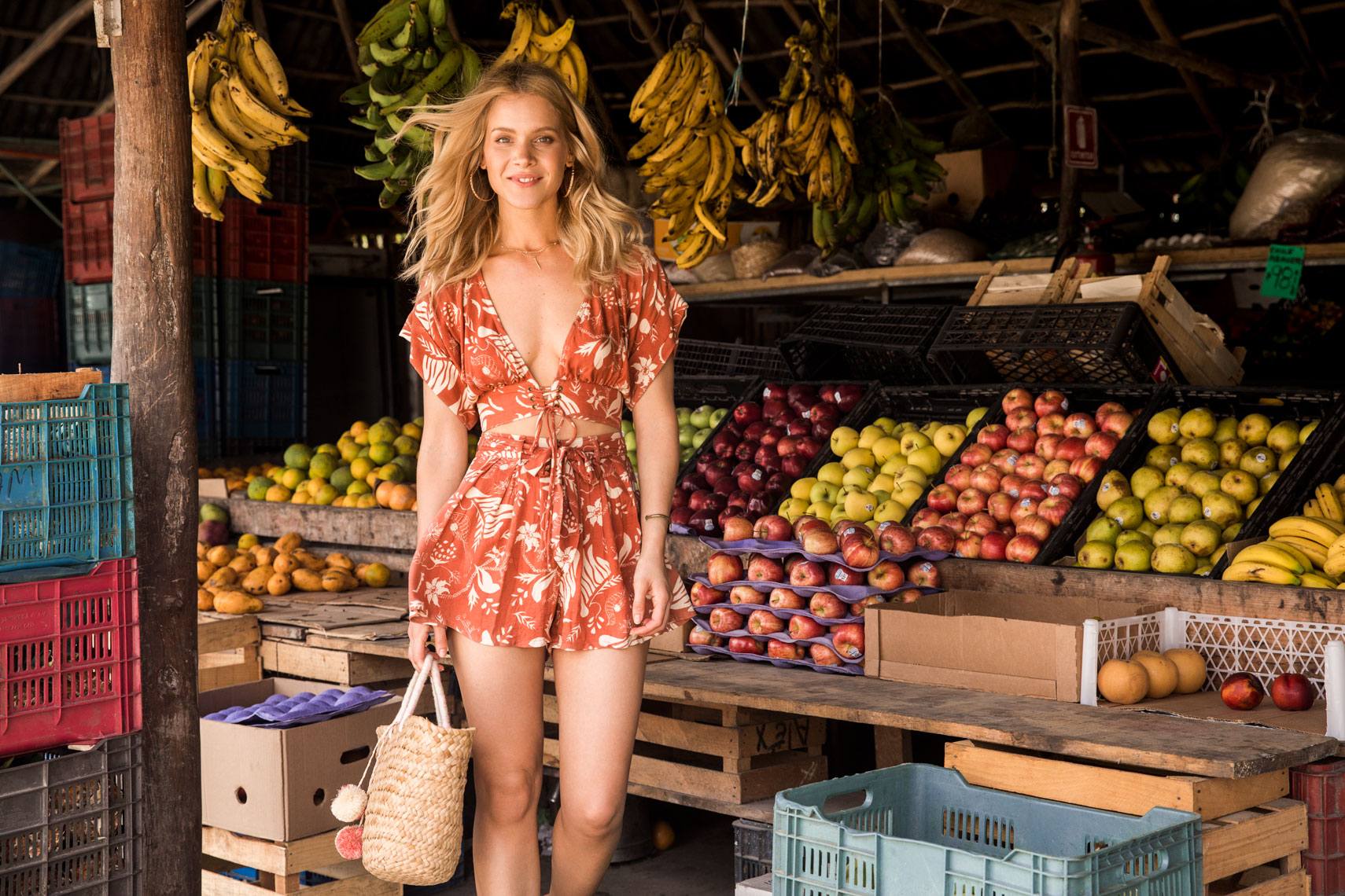 Blonde girl at fruit market in Mexico
