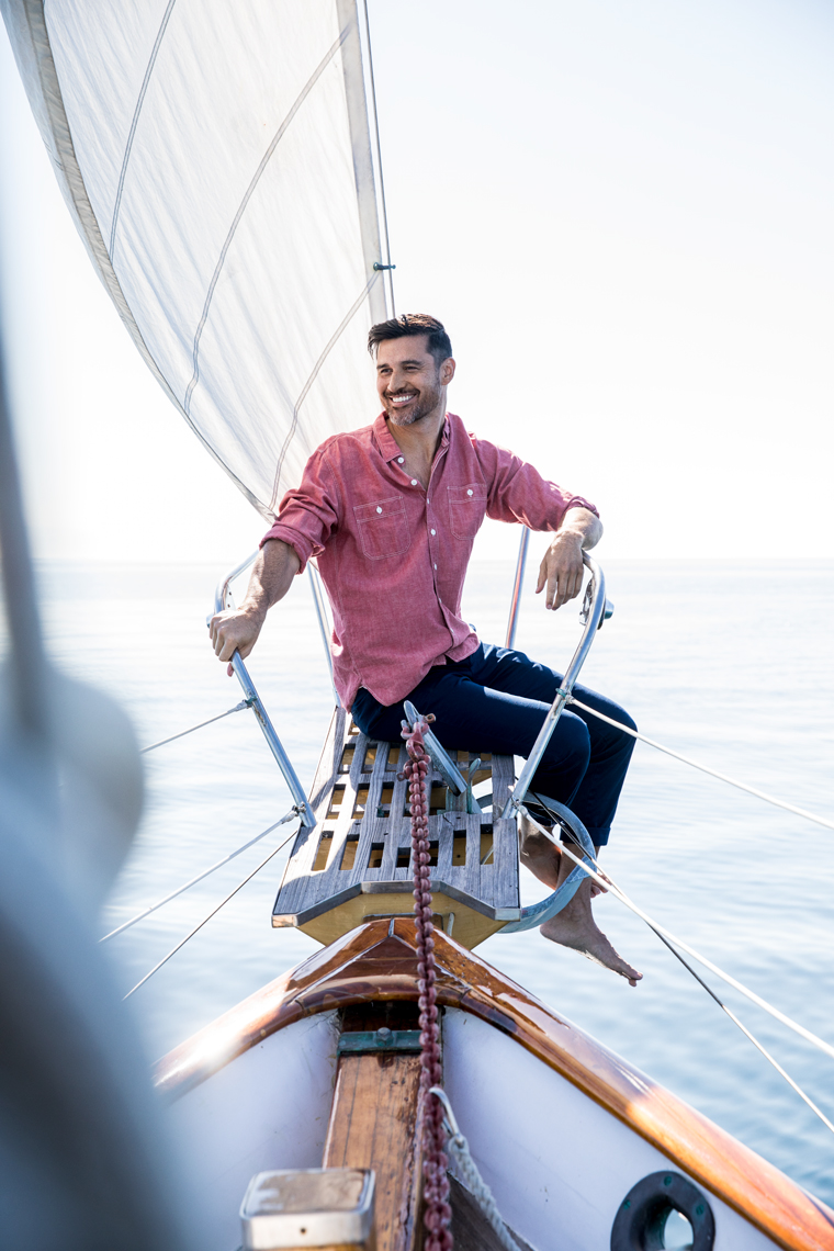 Man sitting on sailboat
