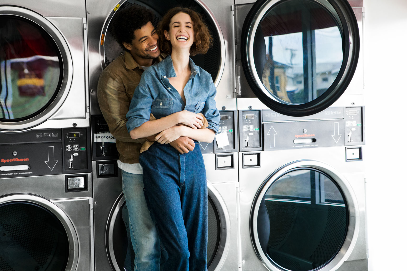 Couple laughing at the laundromat