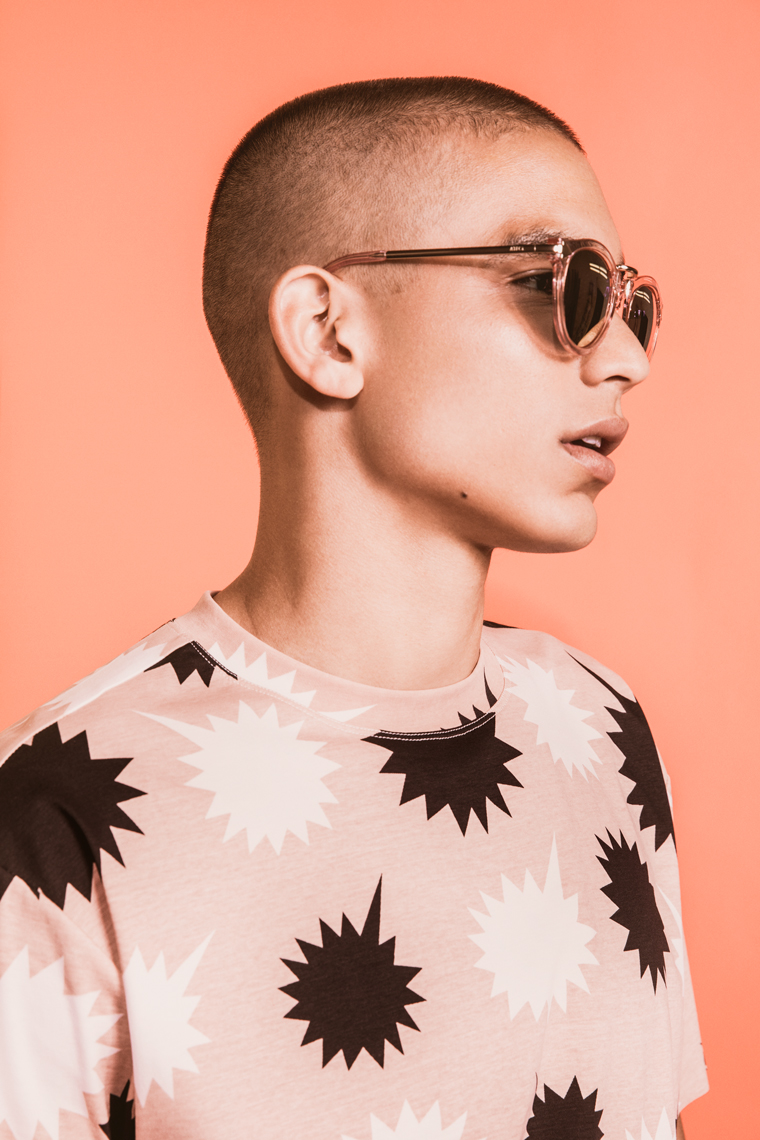 graphic portrait of man with sunglasses on orange background