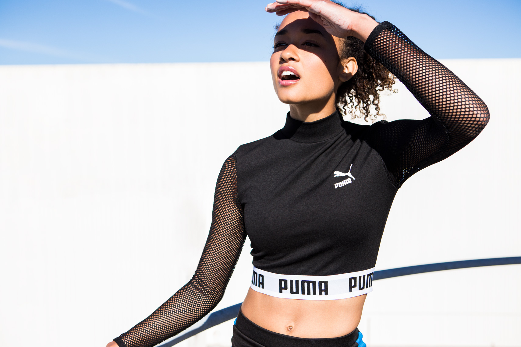 Athletic girl in Puma crop top