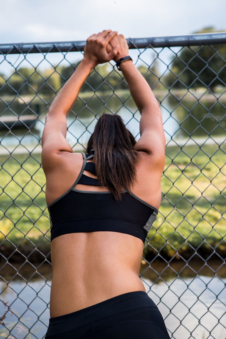 Woman stretching on fence