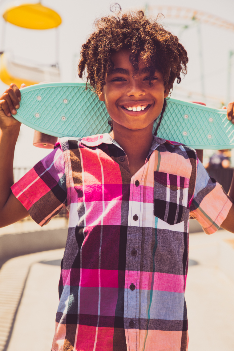 boy laughing with skateboard