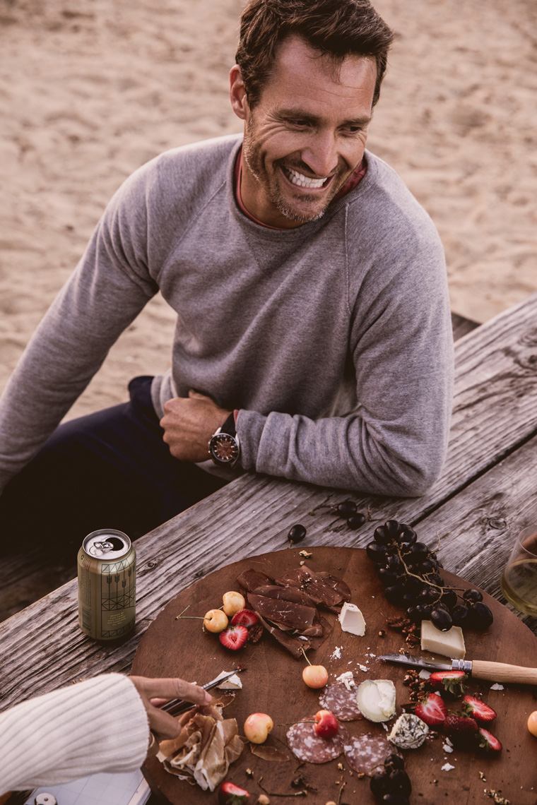 Man laughing at a picnic table