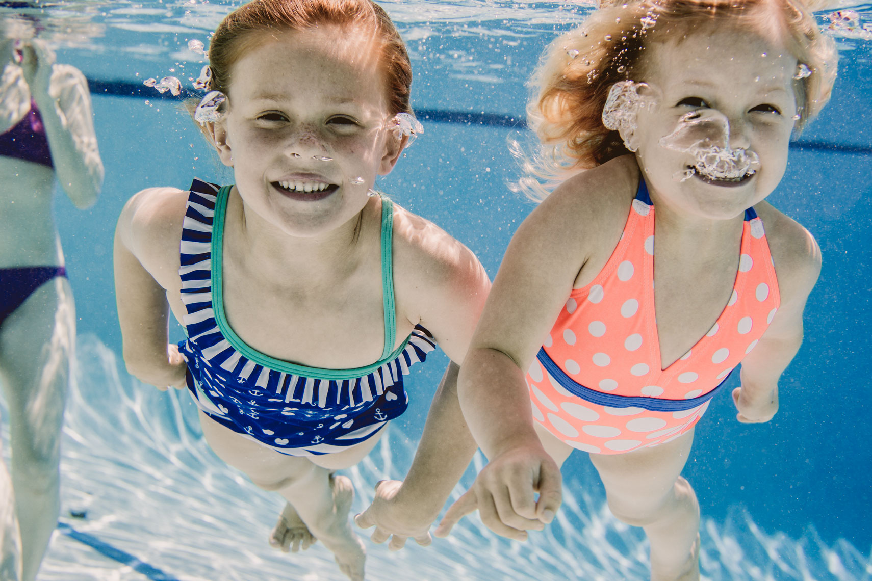 young girls swimming under water