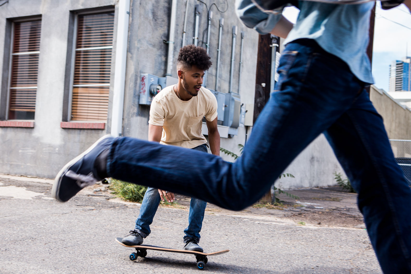 boys skateboarding through streets