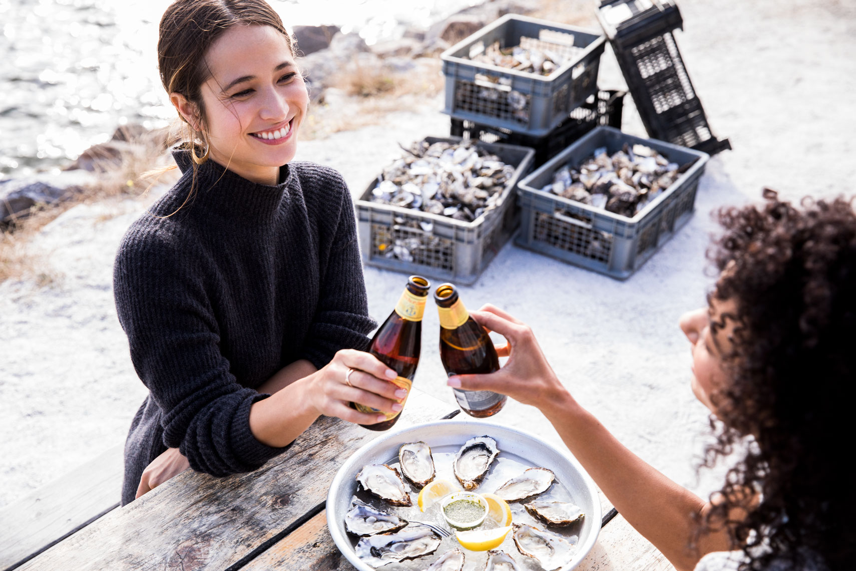 friends eating oysters and drinking beer